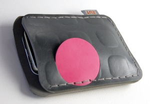 grey rubber phone-case with pink pop-up button
